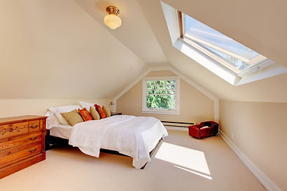 Attic modern bedroom with white bed and