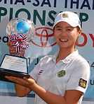 Baek Kyu-jung of South Korea poses with the trophy for the media after winning the KEB Hana Bank Championship golf tournament at Sky72 Golf Club in Incheon