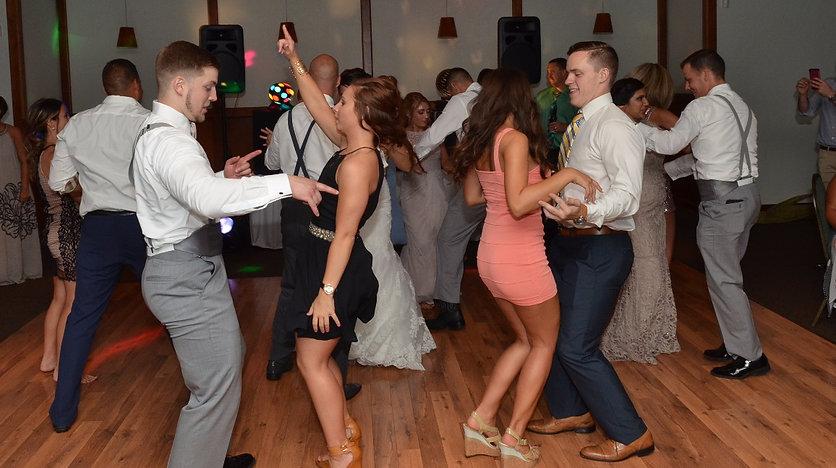 Wedding guests having fun at music man wedding