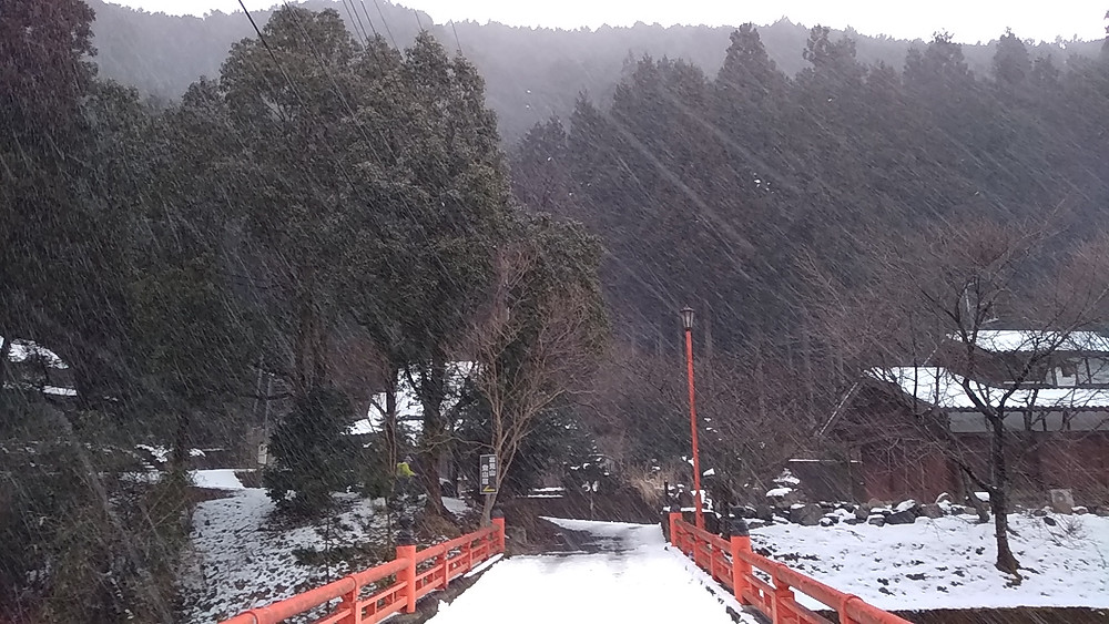 Red bridge on the way to Takasumi onsen