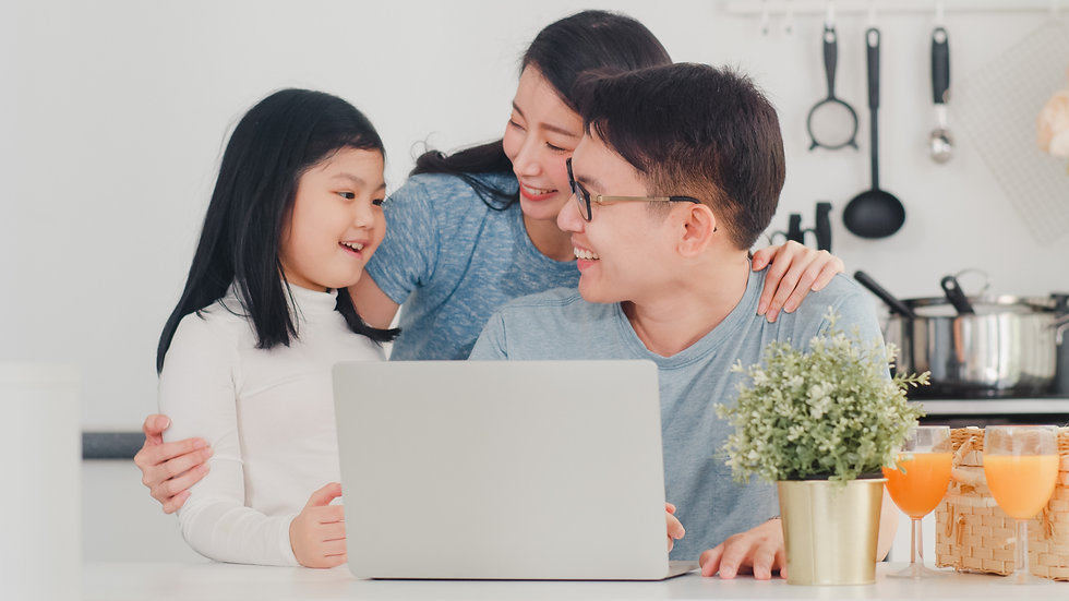 young-asian-family-enjoy-using-laptop-to