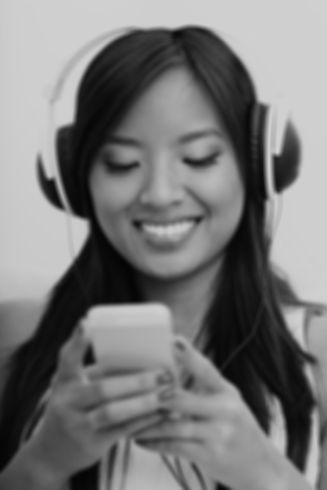 asian-woman-with-phones-and-headphones_e