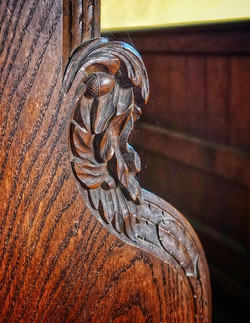 9. Acorn carving on bench end