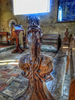 11. 15th century poppy head bench