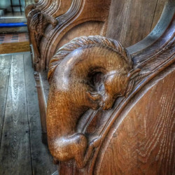 21. Chancel pew unicorn carving