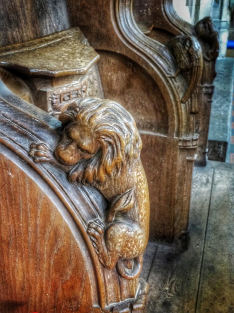 21. Chancel pew lion carving