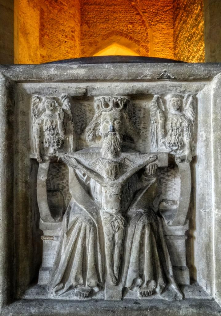 12. Depiction of Holy Trinity on font