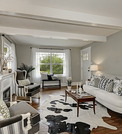 Living room with neutral colors, gray, white, black accents and faux rug