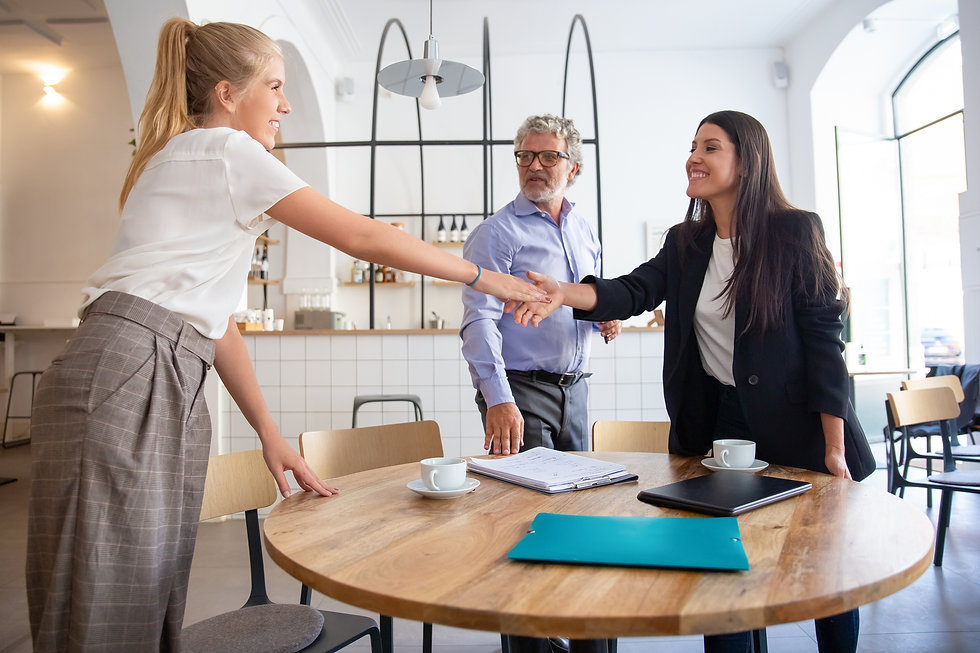 successful-female-business-professional-meeting-with-customers-shaking-hands.jpg