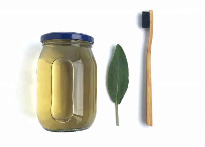 mouth wash in jar, sage leaf, bamboo toothbrush