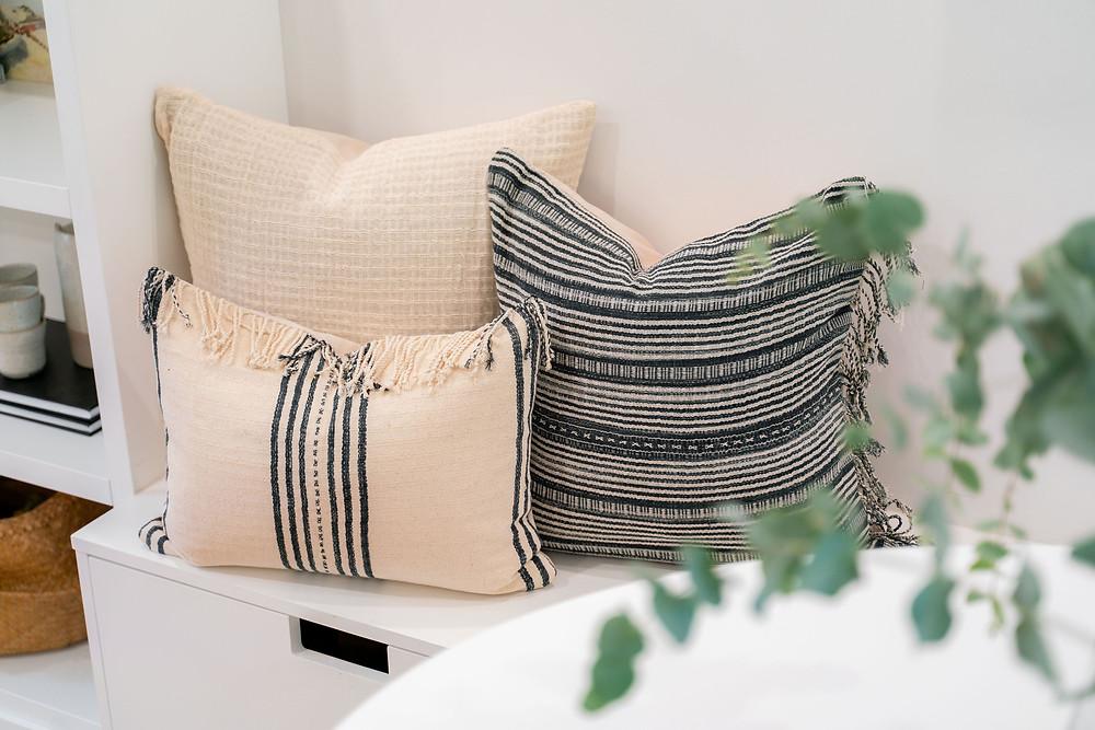 A pair of Rug & Weave's striped Thai Karen pillows