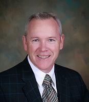 Dr. Kevin E. Bright