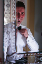 groom getting ready for ring ceremony