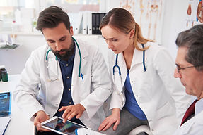 three-doctor-working-with-tablet-in-doctors-office-68XUBQR.jpg