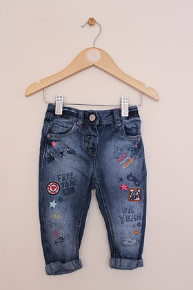 Next jeans with graffiti design (age 6-9 months)