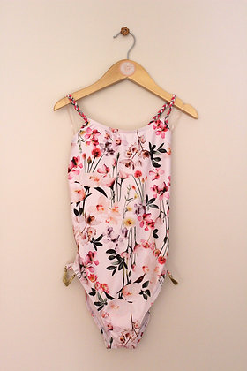 Next pale pink floral swimsuit with ruched sides (age 10)