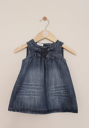 Next denim sleeveless dress with bow decoration (age 3-6 months)