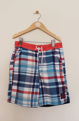 TU blue and red checked swimming shorts (age 7)