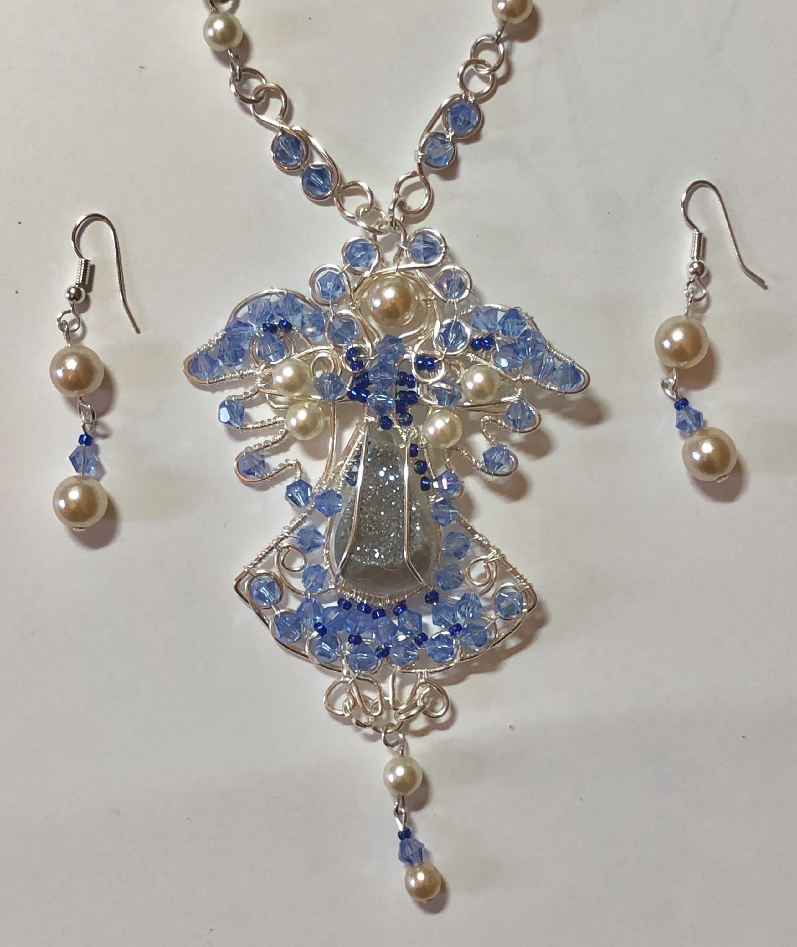 Ange bleu (£90), earrings (£10)