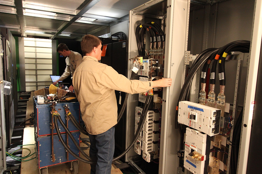 Emerson Techs Testing Breakers