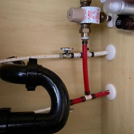 Under Bathroom 1 Sink with pipes