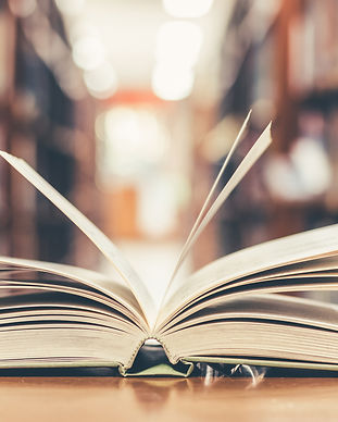 Book in library with old open textbook,