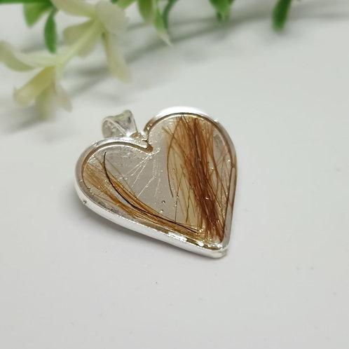 Colgante de Plata de 950 corazón con Crin encapsulado con collar de  caucho