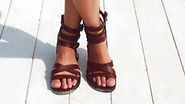 close-up-woman-with-brown-sandals_1140-4