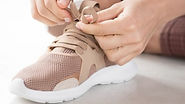 close-up-view-hands-sport-shoes_23-21484