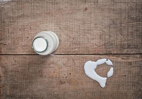 milk in glass bottle on wooden table.jpg