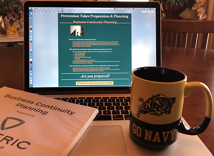 "Artistic image of a ""Go Navy"" coffee cup on a laptop that has Soteric Group LLC's Business Continuity Planning page displayed. A binder with a cover sheet showing the Soteric Group logo and coversheet for a Business Continuity Plan can also be seen."