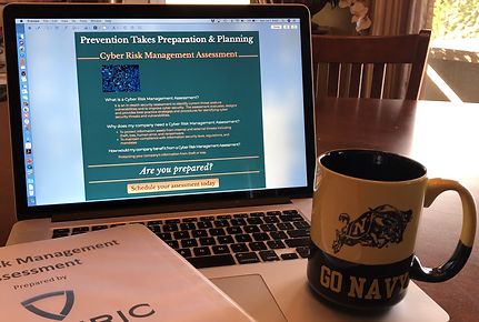 """Artistic image of a """"Go Navy"""" coffee cup on a laptop that has Soteric Group LLC's Cyber Risk Management Assessment page displayed. A binder with a cover sheet showing the Soteric Group logo and coversheet for a Cyber Risk Management Assessment can also be seen."""