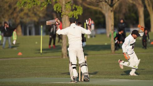 Arif Ahmed celebrates the wicket of Ajmal Afzal