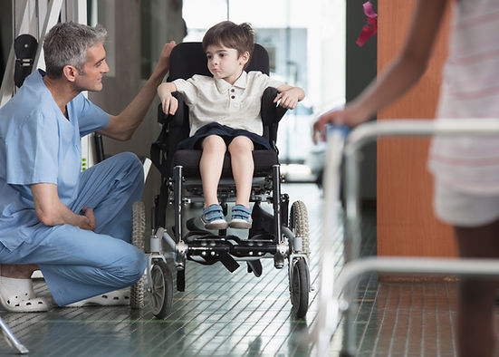 Doctor Talking to Boy in Wheelchair