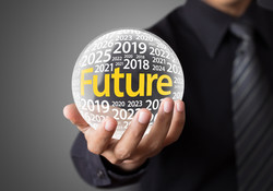 Businessman holding a glass ball,foretelling the future