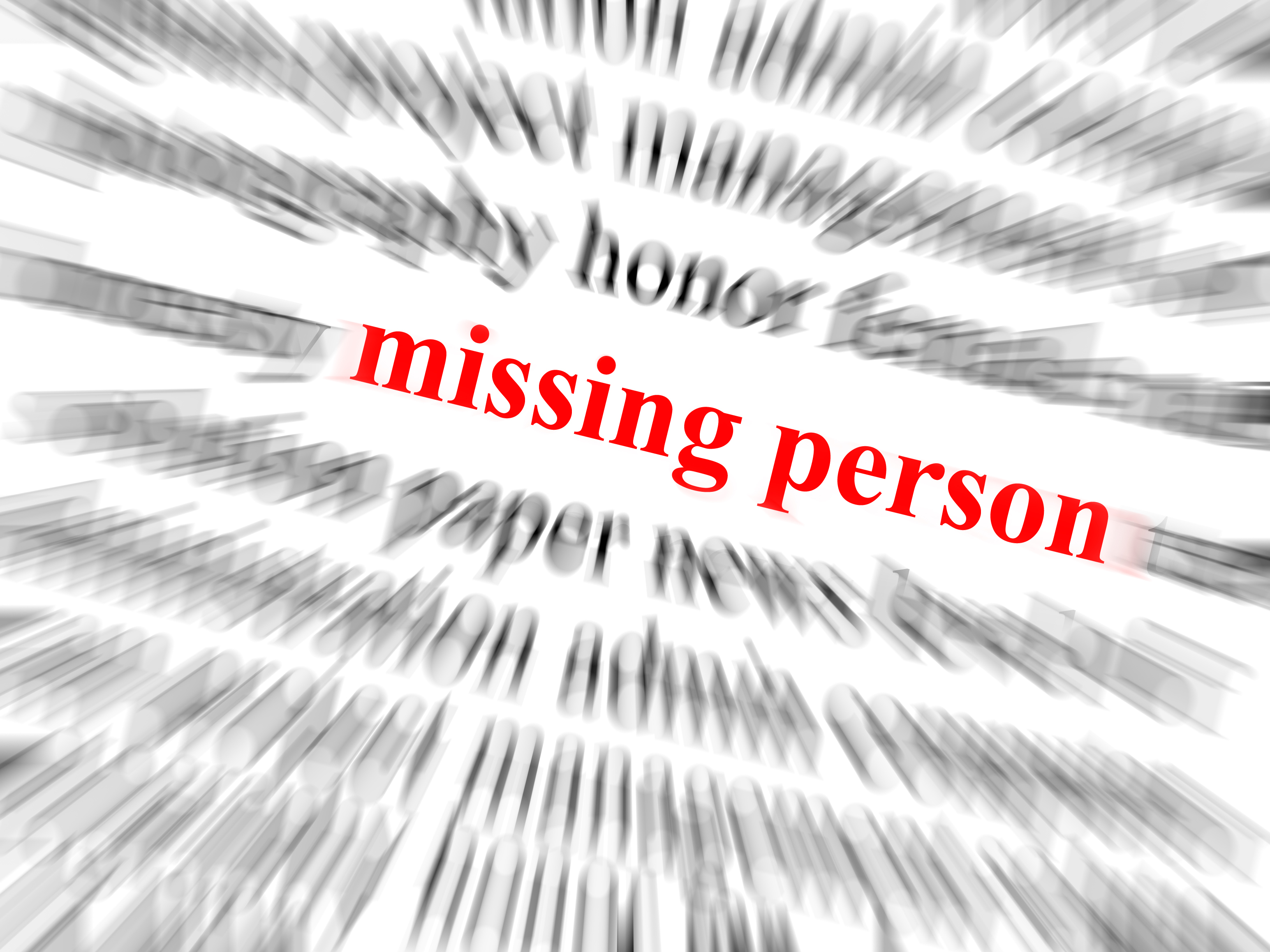 The text missing person in red and in focus.jpg Surrounding text blurred with zoom effect