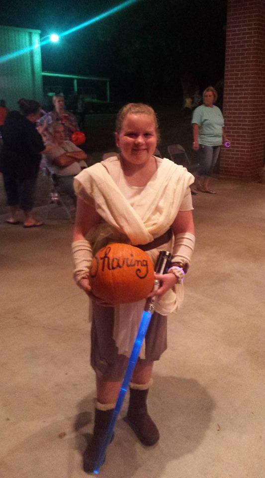 Matti with her pumpkin she won