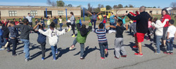 Large group of students during organized recess activities