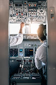 Pilot and copilot inside a cabin flying