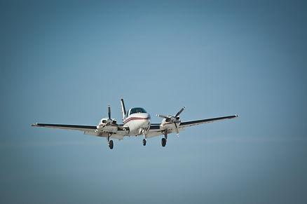 A twin engine light aircraft makes an ap
