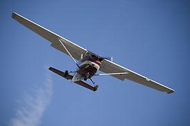 Cessna 172 in the bright blue sky