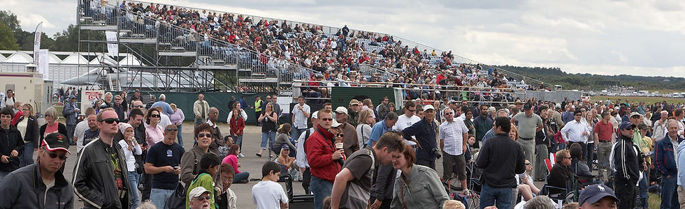 2008_-_crowd_with_grandstand_in_backgrou