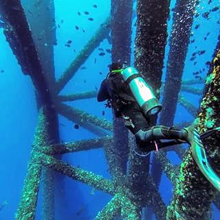 Diver at an oil rig.