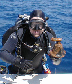 salvage scuba diver holding a recovered