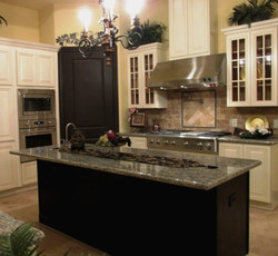 Kitchen cabinets with granite tops.
