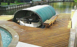 Retractable covered boat slip.