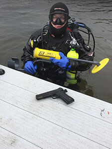 Scuba diver with a recovered weapon.jpg