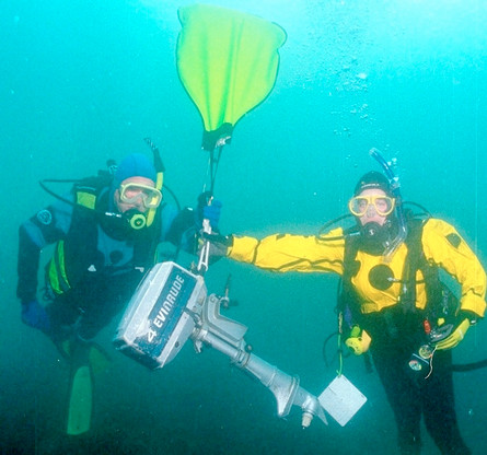 Scuba divers with a boat outboard.jpg