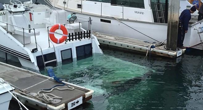 boat sunk in a boat slip, dock.jpg