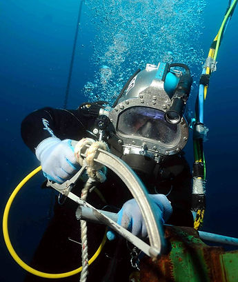 scuba diver with a hack- saw.jpg